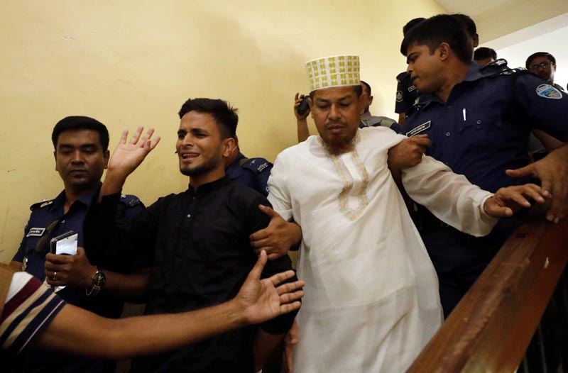 Accused people are taken out of the court premises after they were given death sentences in a murder case in Feni, Bangladesh, October 24, 2019. Photo: Reuters