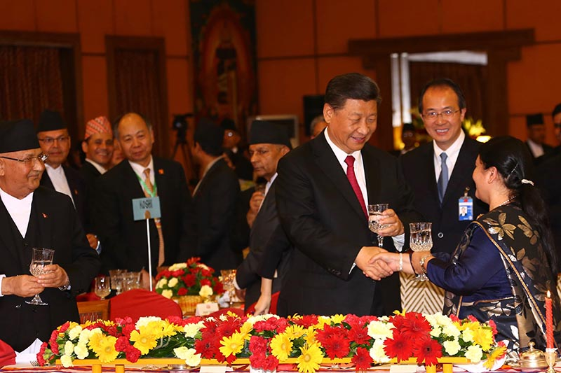 President Bidya Devi Bhandari exchanging greetings with visiting Chinese President Xi Jinping after addressing the state banquet at Hotel Soaltee Crowne Plaza in Kathmandu, on Saturday, October 12, 2019. President Bhandari hosted the  banquet in honour of her visiting Chinese counterpart. Photo: RSS