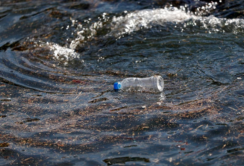 FILE - A plastic bottle drifts on the waves of the sea at a fishing port in Isumi, east of Tokyo, Japan November 21, 2018. Photo: Reuters