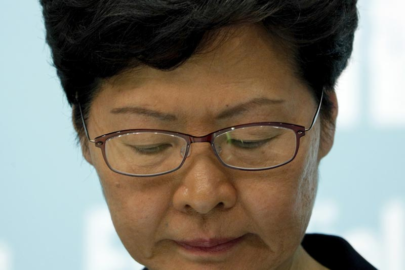 Carrie Lam has banned protesters from wearing masks to conceal their identities in a hardening of the government's stance against the four-month-old demonstrations. Photo: AP