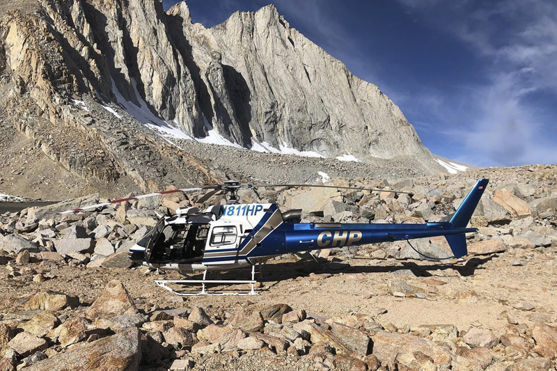 Their H-80 helicopter sits near where a human skeleton was discovered on Mount Williamson, Oct 16, 2019. Photo: California Highway Patrol via AP