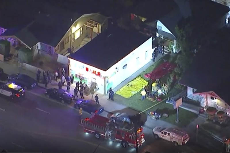 In this aerial image made from video shows the scene where emergency workers have cordoned off an area to deal with victims of a shooting, early Wednesday, Oct. 30, 2019, in Long Beach, Ca. Photo: AP