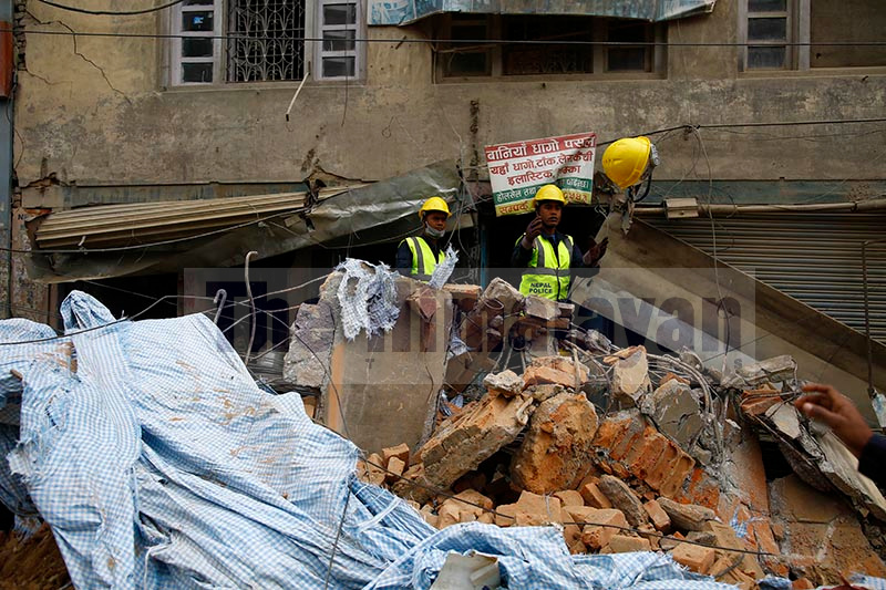 Police personnel work on the scene where an old building that was being demolished collapsed critically injuring a laborer working at the site and a pedestrian at Chabahil in Kathmandu, Nepal on Wednesday, October 23, 2019. Photo: Skanda Gautam/ THT