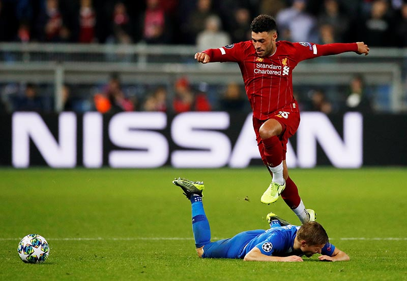 Liverpool's Alex Oxlade-Chamberlain in action with KRC Genk's Jere Uronen during the Champions League Group E match between KRC Genk and Liverpool, at Luminus Arena, in Genk, Belgium, on October 23, 2019 . Photo: Action Images via Reuters