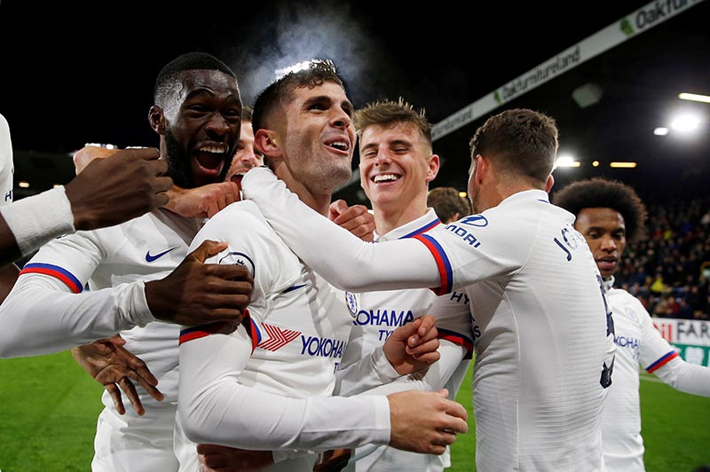 Chelsea's Christian Pulisic celebrates scoring their third goal to complete his hat-trick with team mates during the Premier League match between Burnley and Chelsea, at Turf Moor, in Burnley, Britain, on October 26, 2019. Photo: Action Images via Reuters