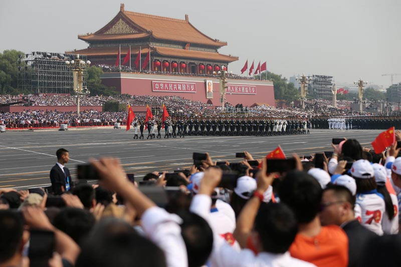 Soldiers of the People's Liberation Army (PLA) march in formation during the military parade marking the 70th anniversary of the founding of the People's Republic of China, on its National Day in Beijing, China October 1, 2019. Photo: China Daily via Reuters
