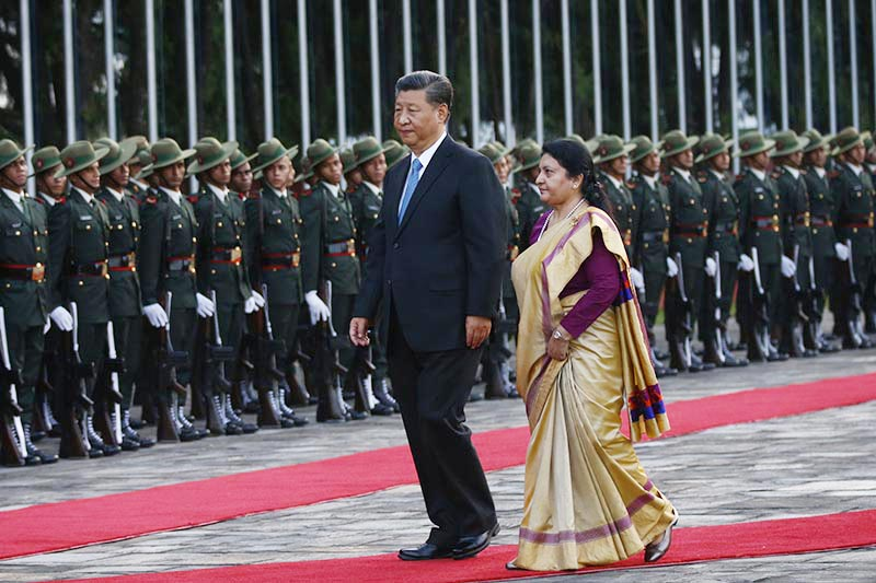 President Bidya Devi Bhandari welcomes and accompanies her Chinese counterpart Xi Jinping along the red carpet while a squad from Nepal Army forms guard of honour at Tribhuvan International Airport, Kathmandu, on Saturday, October 12, 2019. The Chinese President is on a two-day state visit to Nepal at the invitation of his Nepalese counterpart Bidhya Devi Bhandari. This is the visit of a Chinese President to Nepal in the gap of 23 years.