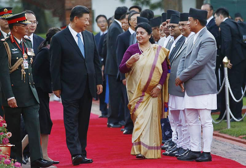President Bidya Devi Bhandari welcomes and accompanies her Chinese counterpart Xi Jinping along the red carpet at Tribhuvan International Airport, Kathmandu, on Saturday, October 12, 2019. The Chinese President is on a two-day state visit to Nepal at the invitation of his Nepalese counterpart Bidhya Devi Bhandari. This is the visit of a Chinese President to Nepal in the gap of 23 years.