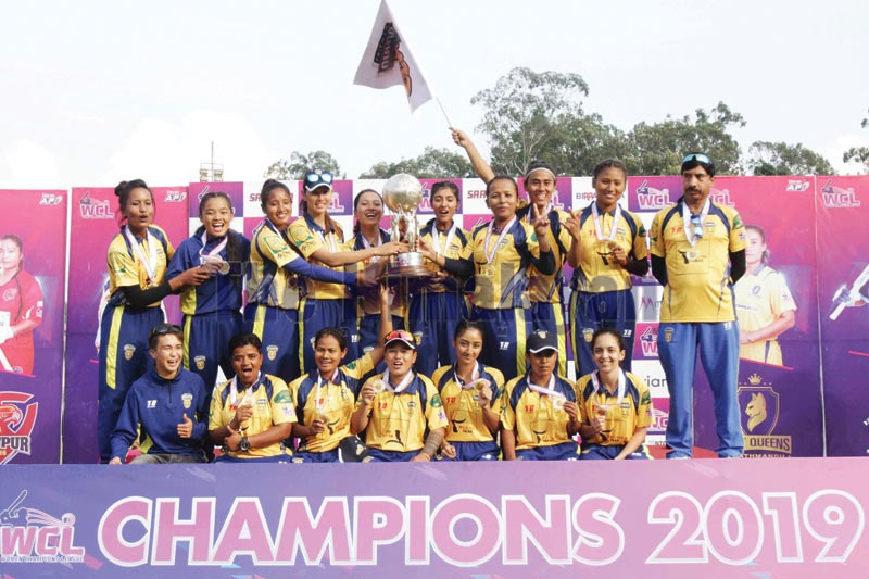 Players and officials of Chitwan Rhinos celebrate with the trophy after winning the Womenu2019s Champions League at the TU Stadium in Kathmandu on Thursday, October 24, 2019.Photo: Udipt Singh Chhetry / THT