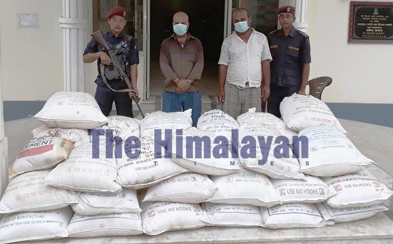 Police making public two persons arrested along with seized customs evaded sugar in District Police Office, Bara, on Sunday, October 20, 2019. Photo: THT