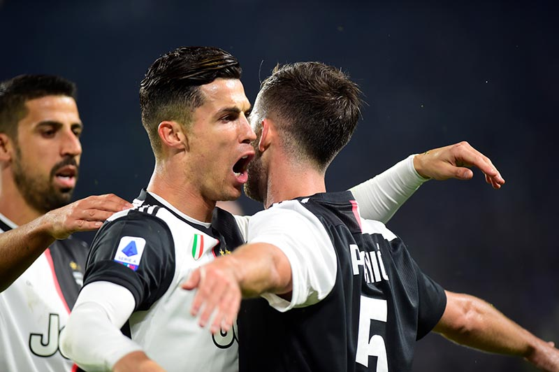 Juventus' Miralem Pjanic celebrates scoring their second goal with Cristiano Ronaldo during the Serie A match between Juventus and Bologna, at Allianz Stadium, in Turin, Italy, on October 19, 2019. Photo: Reuters