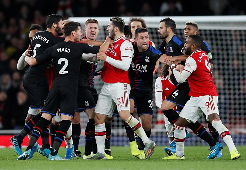 Crystal Palace and Arsenal players clash during the Premier League match between Arsenal and Crystal Palace, at Emirates Stadium, in London, Britain, on October 27, 2019. Photo: Reuters