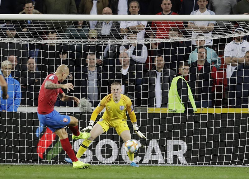 Czech Republic's Zdenek Ondrasek (left) scores his side's second goal during the Euro 2020 group A qualifying soccer match between Czech Republic and England at the Sinobo stadium in Prague, Czech Republic, on Friday, October 11, 2019. Photo: AP