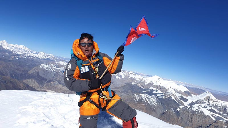 This undated image shows Pasang Dawa Sherpa on top of Himlung Himal