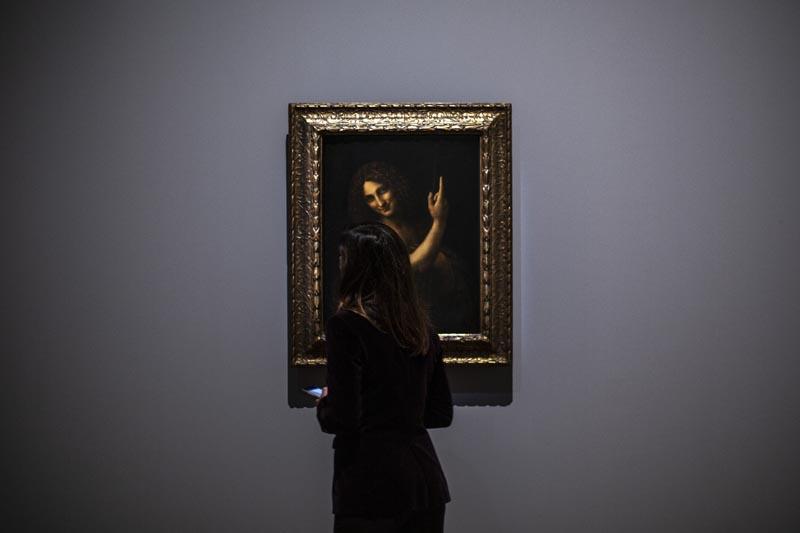 A journalist studies Saint Jean Baptiste artwork by Leonardo da Vinci during a visit at the Louvre museum Sunday, Oct 20, 2019 in Paris. Photo: AP
