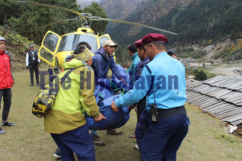 Police preparing to load the body of the deceased into a helicopter at Ruby Valley Rural Municipality-1, in Dhading district, on Sunday, October 20, 2019. Photo: Keshav Adhikari/THT