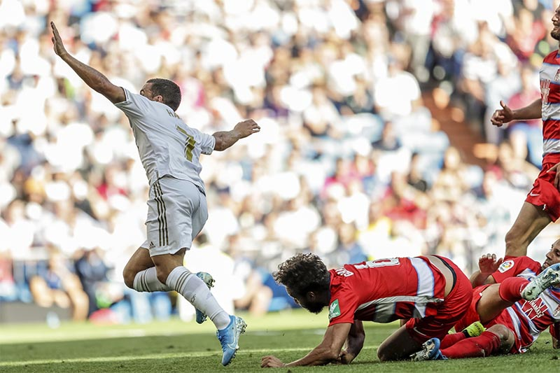 Real Madrid's Eden Hazard celebrates after scoring during the Spanish La Liga soccer match between Real Madrid and Granada at the Santiago Bernarbeu stadium in Madrid, on Saturday, October 5, 2019. Photo: AP