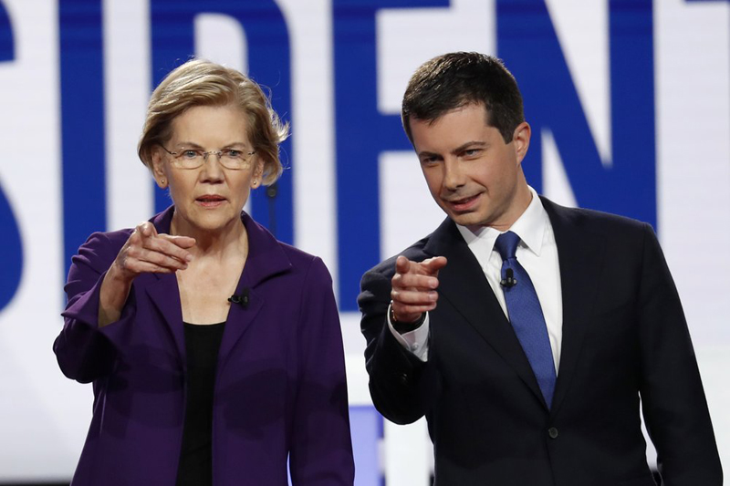 Democratic presidential candidate Senator Elizabeth Warren, D-Mass., left, and South Bend Mayor Pete Buttigieg stand on stage before a Democratic presidential primary debate hosted by CNN/New York Times at Otterbein University, Tuesday, October 15, 2019, in Westerville, Ohio. Photo: APP
