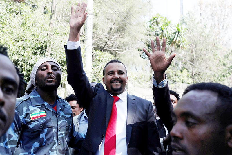 FILE - Jawar Mohammed, an Oromo activist, waves to supporters outside his house in Addis Ababa, Ethiopia, on October 23, 2019. Photo: Reuters