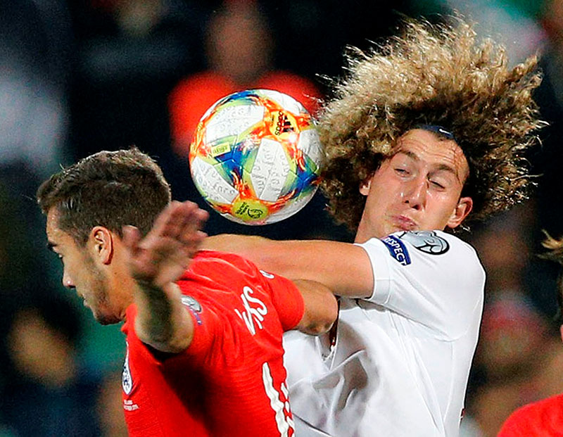 England's Harry Winks in action with Bulgaria's Bozhidar Kraev during the Euro 2020 Qualifier Group A match between Bulgaria and England, at Vasil Levski National Stadium, in Sofia, Bulgaria, on October 14, 2019. Photo: Reuters