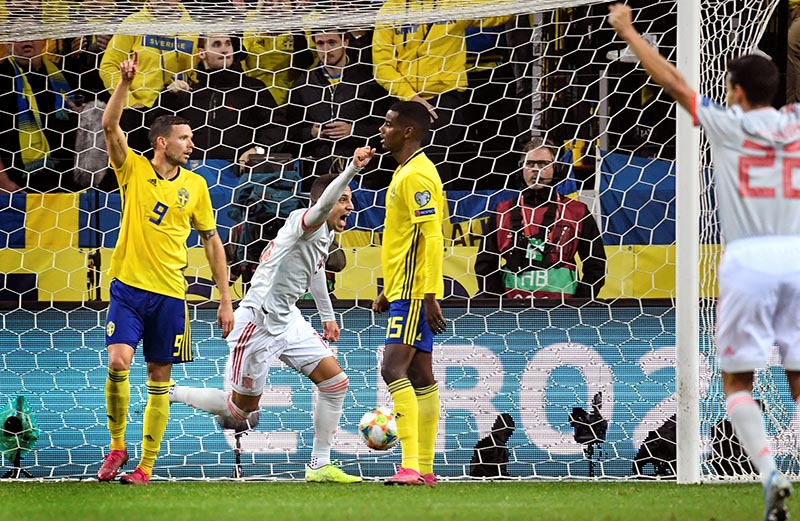 Spain's Rodrigo celebrates after scoring as Sweden's Marcus Berg and Alexander Isak look on during the Euro 2020 Qualifier Group F match between Sweden and Spain, at Solna, in Stockholm, Sweden, on October 15, 2019. Photo: TT News Agency/Anders Wiklund/via Reuters
