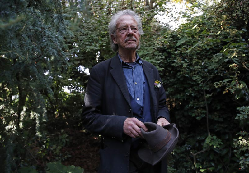 Austrian author Peter Handke poses for a photo in his garden at his house in Chaville near Paris, Thursday, Oct 10, 2019. Photo: AP