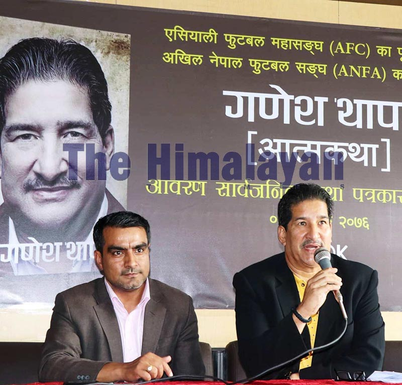 Former President of All Nepal Football Association Ganesh Thapa speaks as founder of Bookhill Publication Pawan Acharya looks on during the unveiling of the cover of his autobiography in Kathmandu, on Sunday, October 20, 2019. Photo: THT