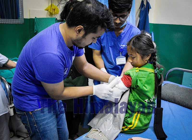An injured schoolgirl undergoing treatment at Green City Hospital after the balcony of a private school collapsed in Dharmasthali, on Wednesday, October 23, 2019. Photo: Naresh Krishna Shrestha/THT