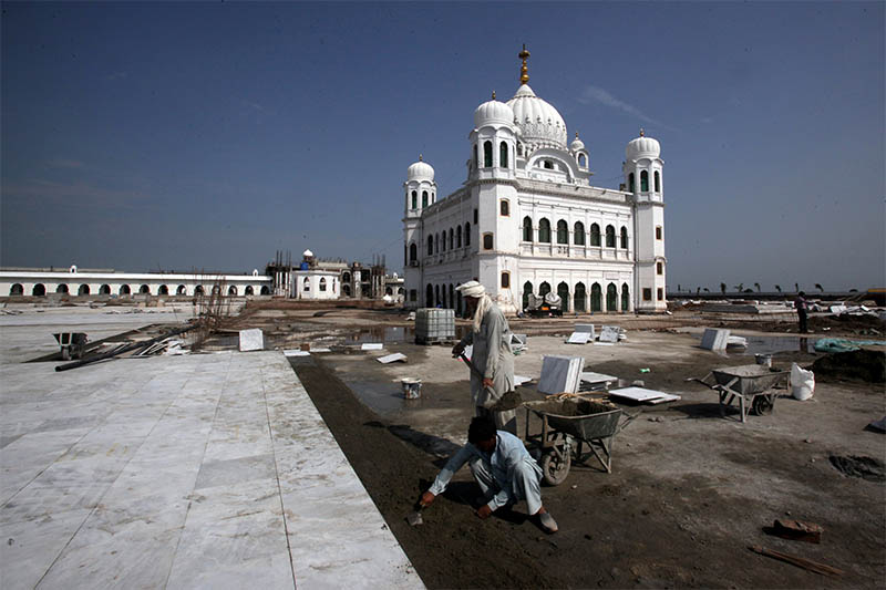 FILE PHOTO: Laborers work at the sites of the Gurdwara Darbar Sahib, which will be open this year for Indian Sikh pilgrims, in Kartarpur, Pakistan September 16, 2019. Photo: Reuters
