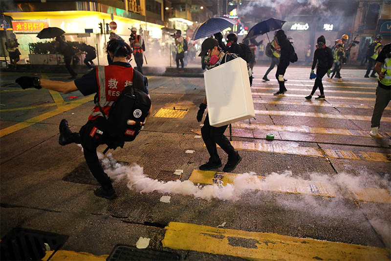An anti-government demonstrator kick a tear gas canister during a protest in Hong Kong, China, October 20, 2019. Photo: Reuters