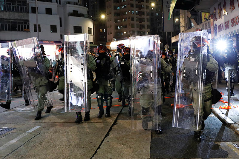 Riot police officers make their way along the street trying to disperse protesters gathering for a demonstration in Hong Kong, China, October 21, 2019. Photo: Reuters