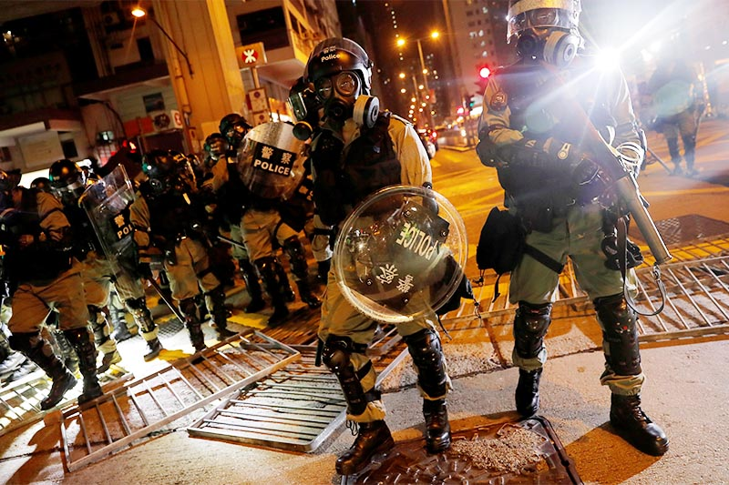 File -  Riot police go through the barricade as they search for anti-government protesters in Hong Kong, China, on October 7, 2019. Photo: Reuters