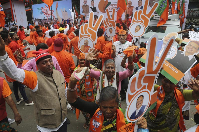 Supporters of India's ruling Bharatiya Janata Party celebrate outside their party office in Mumbai, India, Thursday, Oct 24, 2019. Photo: AP