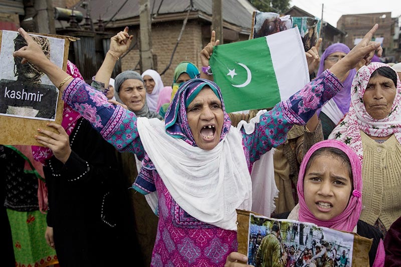 Kashmiris shout slogans during a protest after Friday prayers against the abrogation of article 370, on the outskirts of Srinagar, Indian controlled Kashmir, on Friday, October 4, 2019. Photo: AP