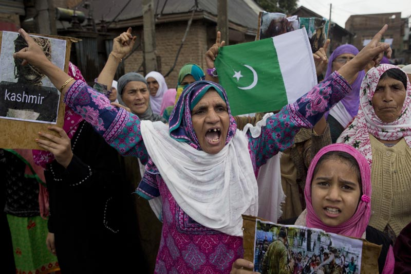 Kashmiris shout slogans during a protest after Friday prayers against the abrogation of article 370, on the outskirts of Srinagar, Indian controlled Kashmir, Friday, Oct 4, 2019. Photo: AP