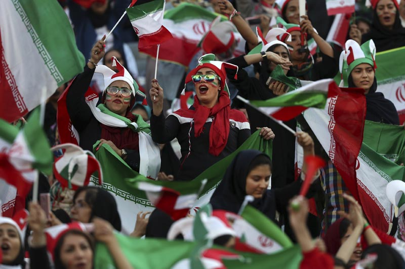 Iranian women cheer during a soccer match between their national team and Cambodia in the 2022 World Cup qualifier at the Azadi (Freedom) Stadium in Tehran, Iran, Thursday, October 10, 2019. Photo: AP