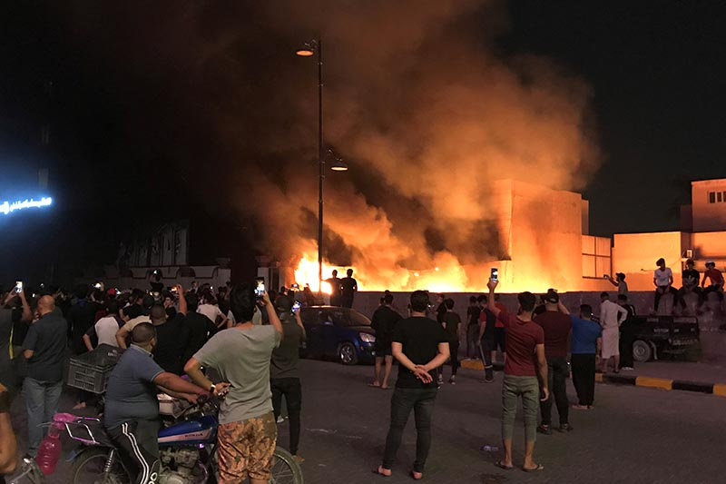Demonstrators set on fire the Hikma movement building during a protest over unemployment, corruption and poor public services, in Najaf, Iraq October 2, 2019. Photo: Reuters
