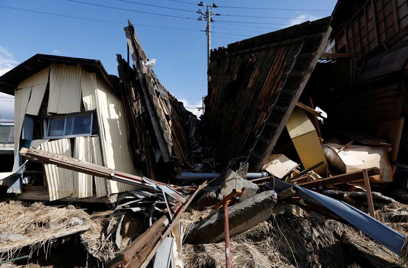 Destroyed houses are seen, in the aftermath of Typhoon Hagibis, in Koriyama, Fukushima prefecture, Japan October 15, 2019. Photo: Reuters