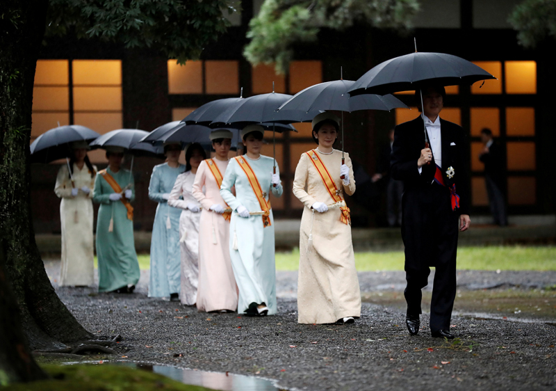 Japan's Crown Prince Akishino and Crown Princess Kiko arrive at the ceremony site where Emperor Naruhito will report the conduct of the enthronement ceremony at the Imperial Sanctuary inside the Imperial Palace in Tokyo, Japan October 22, 2019. Photo: Reuters