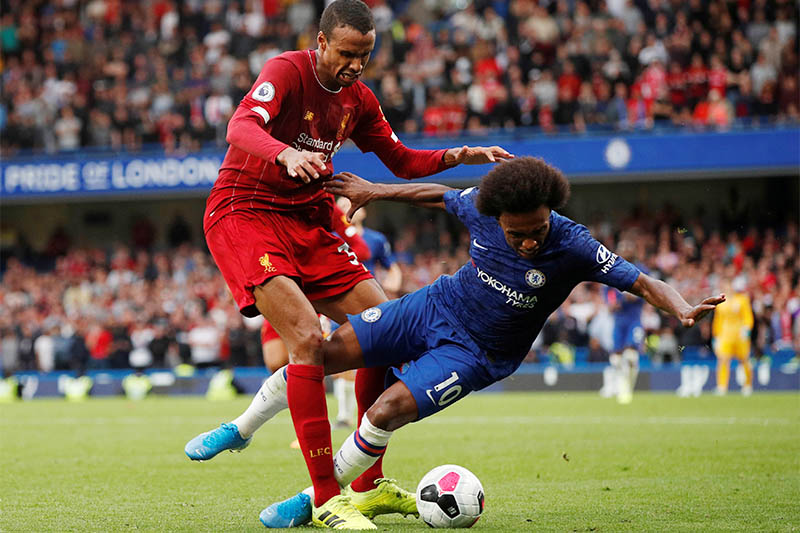 Liverpool's Joel Matip in action with Chelsea's Willian. Photo: Reuters