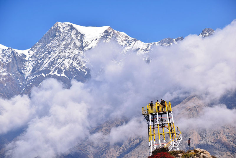 Tourists enjoying mountain ranges from Yaruju View tower located at Thini, Gharpajhong Rural Municipality-5 of Mustang district, on Friday, October 25, 2019. Photo: RSS