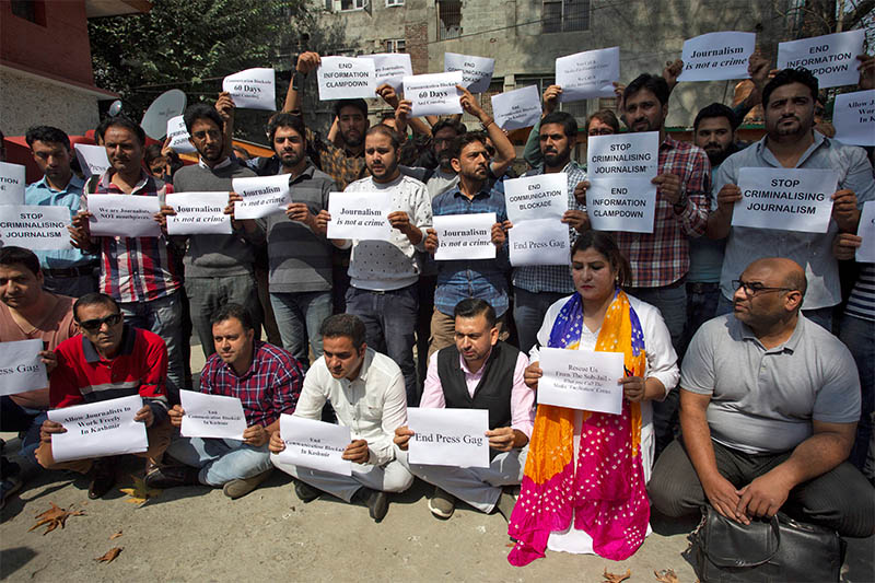 Journalists hold placards as they attend a silent protest against the communication blockade, following the scrapping of the special constitutional status for Kashmir by the Indian government, in Srinagar, October 3, 2019. Photo: Reuters