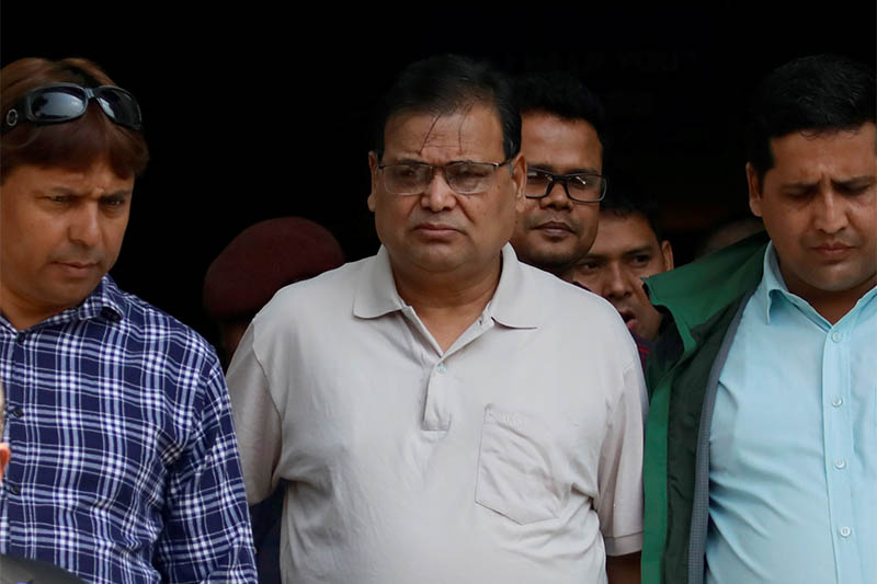 Krishna Bahadur Mahara (C) who resigned from his post as a speaker of the House of Representatives in Nepal's parliament after an accusation made by a female parliament employee that he raped her,  heads towards the court in Kathmandu, Nepal October 15, 2019. Photo: Reuters