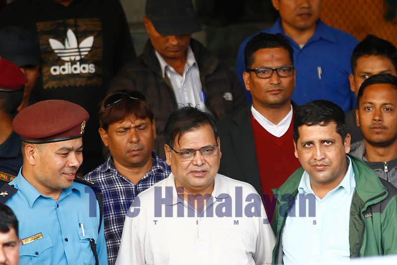 FILE - Former speaker of the House of Representatives, Krishna Bahadur Mahara (C) leaves the Kathmandu District Court after giving his statement following accusation by a female government employee, who accused him of attempt-to-rape, in Kathmandu, on Tuesday, October 15, 2019. Photo: Skanda Gautam/THT