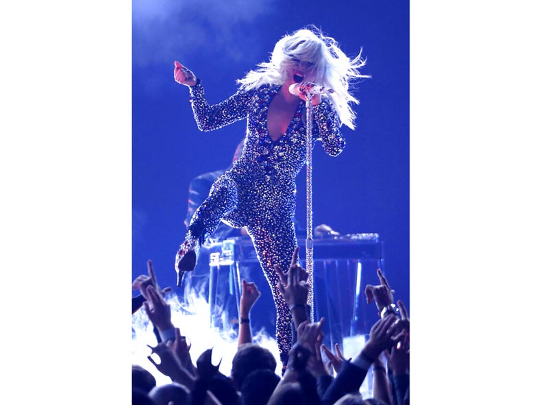 Lady Gaga is recovering after falling off stage while dancing with a fan at a concert. Photo: AP