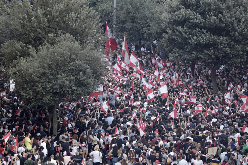 Anti-government protesters shout slogans against the Lebanese government during a protest in Beirut, Lebanon, Saturday, Oct 19, 2019. Photo: AP