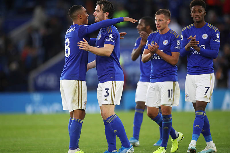 Leicester City players applaud fans after the match. Photo: Reuters