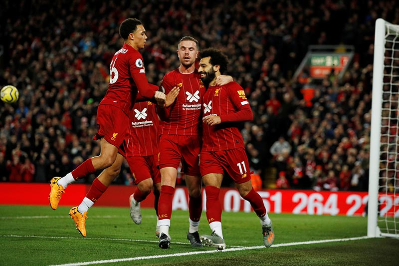 Liverpool's Mohamed Salah celebrates scoring their second goal with teammates during the Premier League match between Liverpool and Tottenham Hotspur, at Anfield, in Liverpool, Britain, on October 27, 2019. Photo: Reuters