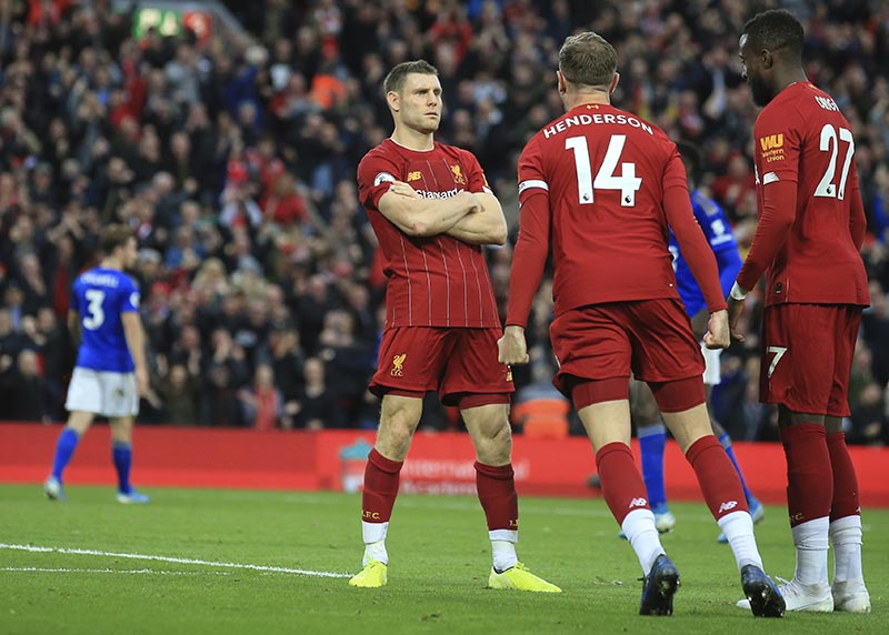 Liverpool's James Milner celebrates his wining goal with Liverpool's Jordan Henderson and Liverpool's Divock Origi during English Premier League soccer match between Liverpool and Leicester City in Anfield stadium in Liverpool, England, on Saturday, October 5, 2019. Photo: AP