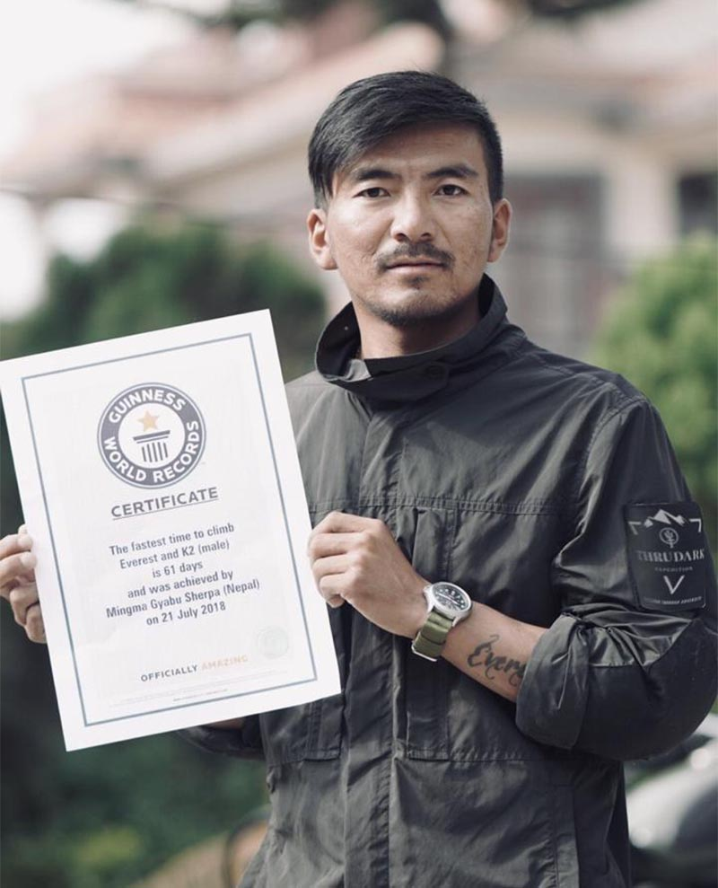 Mingma Gyabu displays the official certificate given by the Guinness World Records for the fastest ascents of Mt Everest and Mt K2. Photo: THT
